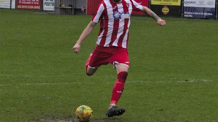 Miles Powell fires home the winning penalty for Felixstowe & Walton in their Velocity Trophy win ove
