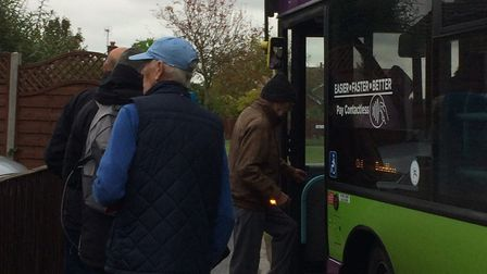 Elderly residents boarding the bus this morning. Picture: KATE SPICER