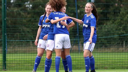 Eloise King celebrates her second goal with team-mates Maddie Biggs, Abbie Lafayette and Chloe Dunn