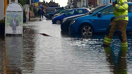 Firefighters battling the floodwater in Aldeburgh Picture: JAYNE DALE