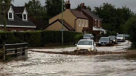 Flooding at the junction of Judith Avenue and Leiston Rd in Knodishall Picture; PAUL WILSON