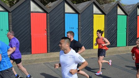 Runners tackling the Lowestoft parkrun, with colourful beach-huts in the background. Picture: LOWEST