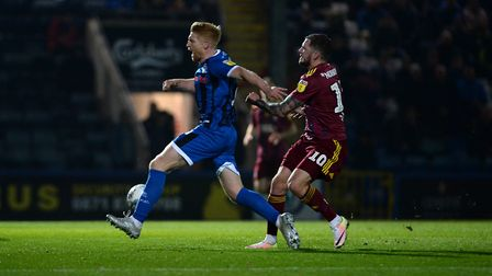 Ipswich's James Norwood is booked for this push on Paul McShane at Rochdale Picture Pagepix