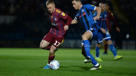Danny Rowe under pressure from Ian Henderson at Rochdale Picture Pagepix