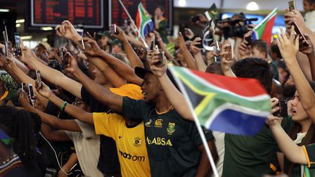 Fans await the arrival of their world champion South Africa Springbok rugby side at the airport. Pic
