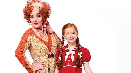 Lesley Joseph as Miss Hannigan with Annie and Sandy in the new production of Annie, now at the Ipswi