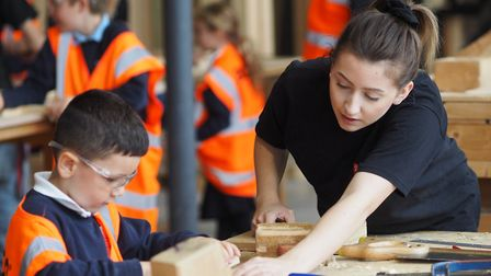 Students and pupils work together on the crosses Picture: WEST SUFFOLK COLLEGE