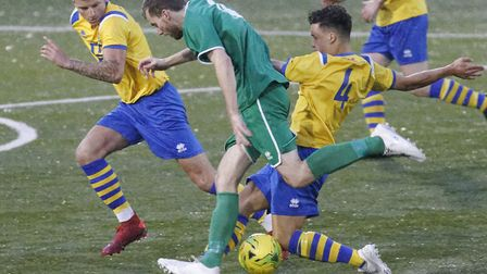 AFC Sudbury's Ben Hammett tackles Robert Lacey during last weekend's 2-1 home win over Canvey Island
