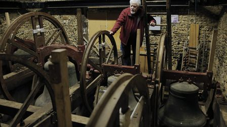 Winston Girling, captain of the tower, looking at the frame which currently holds the bells in place