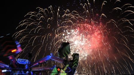 Flash, bang, wallop: Fireworks, bonfire and funfair light up the night sky in Long Melford. Picture:
