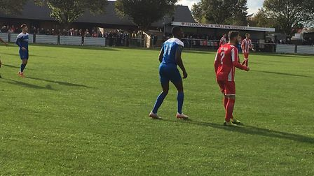Bury Town's Colin Oppong and Felixstowe & Walton United's full-back Callum Bennett, in action at Del