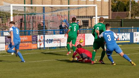 Will Davies wheels away after firing Leiston into the lead against Hitchin. Photo: PAUL VOLLER