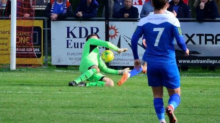 Seasiders' keeper, Danny Crump, blocks this effort from Cemal Ramadan, with Jake Chambers-Shaw (No.
