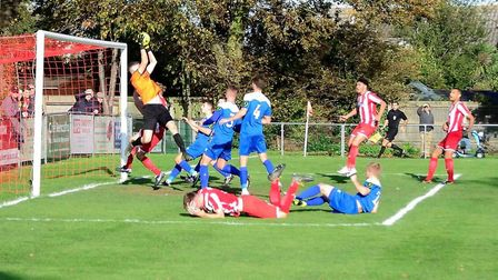 Bury Town keeper Dan Barden, who had a relatively quiet afternoon, puts a stop to this rare Felixsto
