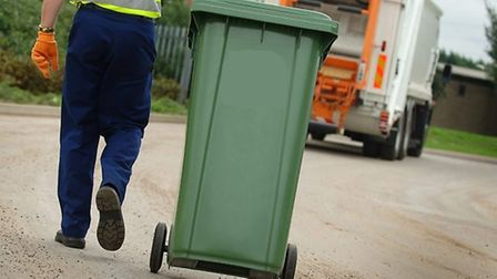 Making sure the correct waste is in green, blue and black bins helps environmental measures. Picture