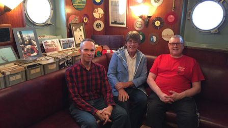 Mike Read in the record library on the Ross Revenge with Radio Caroline DJs Nick Jackson, left, and