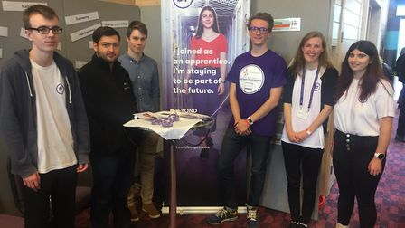 Six former students from One Sixth Form College who are now apprentices at BT Adastral Park, backing