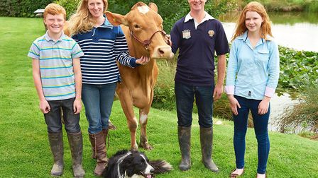 Katharine and Jason Salisbury with their children James and Emily, Edd the sheepdog and one of their