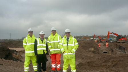Ipswich Borough Council leader David Ellesmere (second left) with contractors at the Sproughton sug