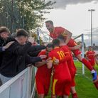 Needham Market players celebrate with away fans after going 2-0 up, at Lowestoft Town. Picture: BEN
