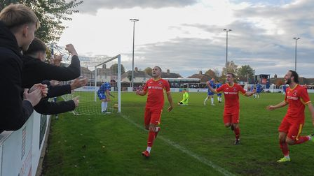 Happy times as Needham Market players celebrate scoring a second goal, in a 2-0 win at Crown Meadow.