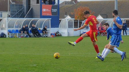 Joe Neal cracks in a shot during Needham Market's 2-0 win at Lowestoft Town. Picture: BEN POOLEY