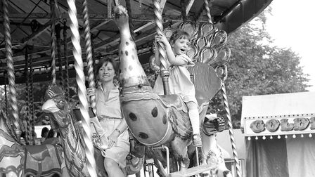 These two certainly seem to be enjoying the carousel Picture: JERRY TURNER
