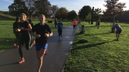 Runners enjoy the bright sunshine during the Burgess parkrun, held over a fast, flat course in Burge