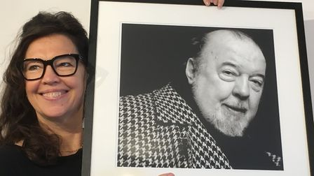 Theatre-maker Jenny Hall holding a portrait of her father Suffolk-born Sir Peter Hall, founder of th