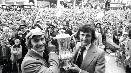 Ipswich Town captain Mick Mills, left, and Roger Osborne, celebrate with the FA Cup during a civic r