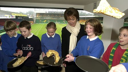 Delia Smith and children from Brundle and Hillside Community Primary schools toss pancakes at Carrow
