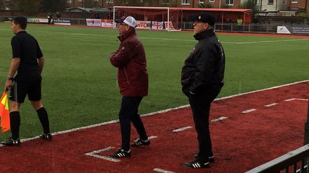 AFC Sudbury's managament team of Danny Laws (assistant) and Mark Morsley (manager) watch from the si