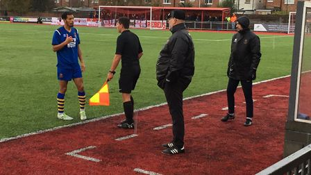 Reece Harris, who scored the opening goal, talks to the assistant referee in front of the AFC Sudbur