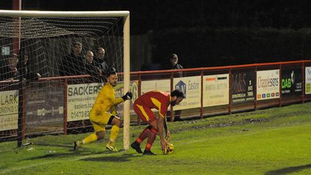 James Baker nets an injury-time goal, but Needham Market still bowed out of the FA Trophy at the han
