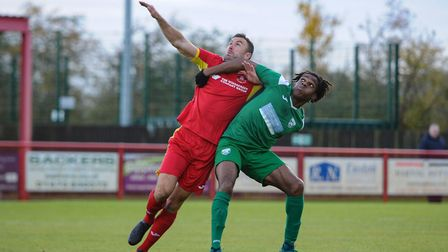 Gareth Heath contests a high ball during Needham Market's FA Trophy defeat to Leatherhead. Picture: