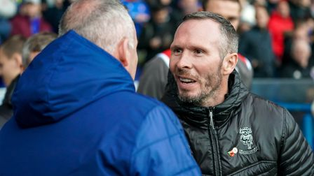 Town manager Paul Lambert and Lincoln City boss Michael Appleton shake hands ahead of the Town v Lin