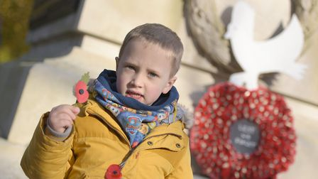 Riley Alcock with his poppy Picture: SARAH LUCY BROWN