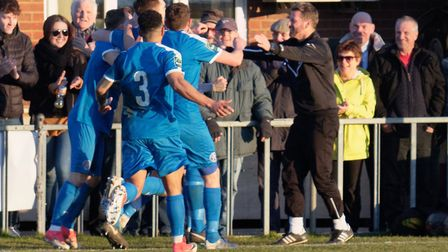 Leiston players celebrate with boss Glen Driver en route to a win over Billericay when Driver was l