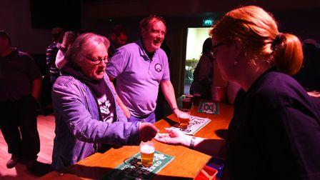 Mine's a pint! The Beccles Beer Festival at the Public Hall in Beccles. Picture: James Bass