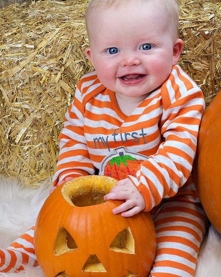 Playing with a pumpkin, Erin, who is seven months old Picture: RUTH LEACH