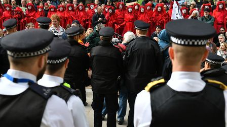 Police guard protesters outside the Treasury in Westminster, London, during an Extinction Rebellion