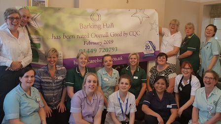 Staff at Barking Hall Nursing Home at Needham Market, with Beth Harvey in the front row, celebrate t