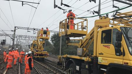 Network Rail engineers repairing the damaged wires between Colchester and Marks Tey. Picture; NETWOR