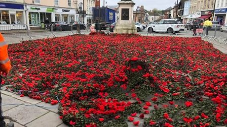 The poppy cascade is installed at St Peter's church in Sudbury town centre Picture: TODD BELLARIUS