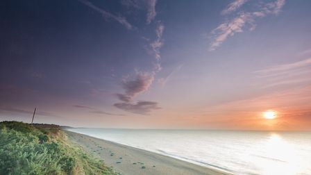 Sunrise over Dunwich Heath and beach Picture: RICHARD SCOTT/NATIONAL TRUST IMAGES