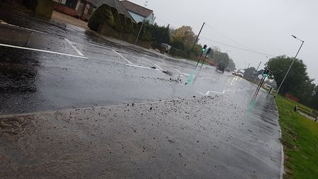 The burst pipe has caused sewage and tarmac to spread onto the road Picture: Rachel Edge