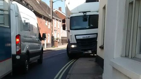 Lorries, vans and HGV have to mount the pavement in Benton Street, Hadleigh, to pass one another, co