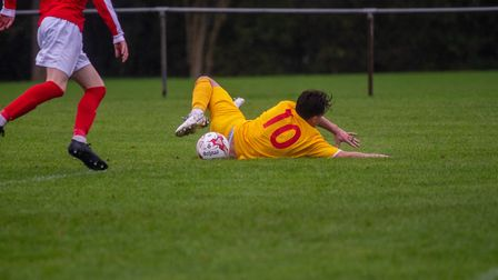 Walsham's Ryan Clark is felled in the box against Mildenhall, resulting in a penalty. Picture: HANNA