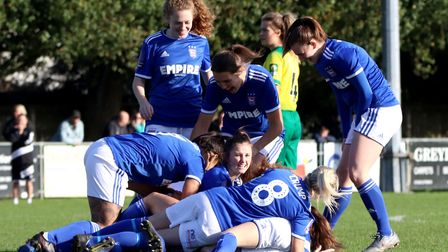 Anna Grey is bundled after scoring the opening goal in Town Women's 6-1 win over Norwich City in the