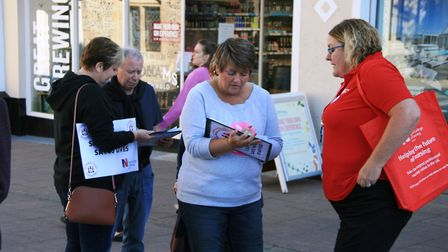 Nurse Helen Maw, pictured here in Bury St Edmunds urging people to sign a petition for safer staffin
